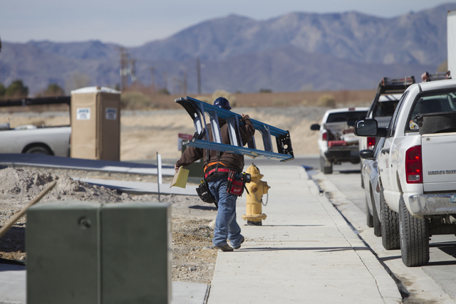 A construction worker carries a ladder while working on a home at the Burson Ranch community by Beazer Homes, Thursday, Feb. 16, 2017, in Pahrump, Nev. (Erik Verduzco/Las Vegas Review-Journal) @Er ...
