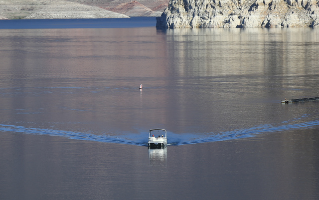 A boat moves through the water at Lake Mead National Recreation Area on Tuesday, Feb. 14, 2017. (Chase Stevens/Las Vegas Review-Journal) @csstevensphoto