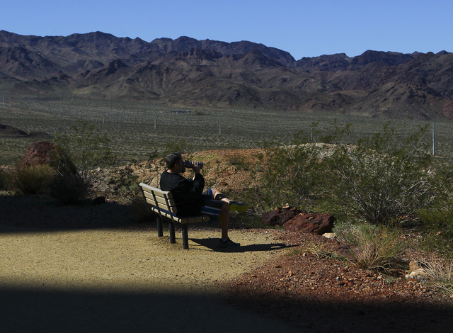 Kurt Zingelman of Boulder City hydrates while taking in a view of the lake along the Historic Railroad Trail at Lake Mead National Recreation Area on Tuesday, Feb. 14, 2017. (Chase Stevens/Las Veg ...