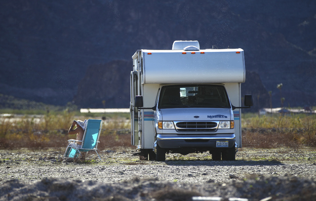 A man relaxes by an RV at Boulder Beach at Lake Mead National Recreation Area on Tuesday, Feb. 14, 2017. Chase Stevens/Las Vegas Review-Journal) @csstevensphoto