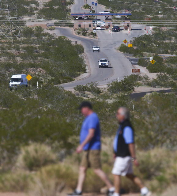 Vehicles come and go from the entrance station, above, as people hike along the Historic Railroad Trail at Lake Mead National Recreation Area on Tuesday, Feb. 14, 2017. (Chase Stevens/Las Vegas Re ...