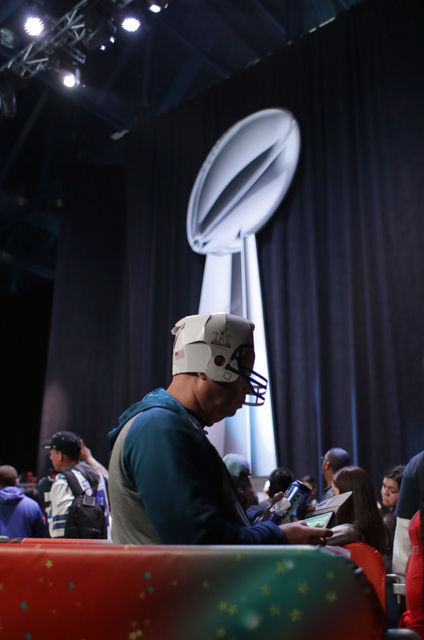 Fans wait in line to view the Lombardi trophy at the NFL Experience ahead Super Bowl 51 Friday, Feb. 3, 2017, in Houston. The Atlanta Falcons will face the New England Patriots in the Super Bowl S ...
