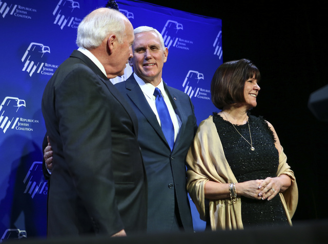 Former Vice President Dick Cheney, left, greets Vice President Mike Pence, along with his wife Karen, before a dinner at the Republican Jewish Coalition's annual leadership meeting at the Venetian ...
