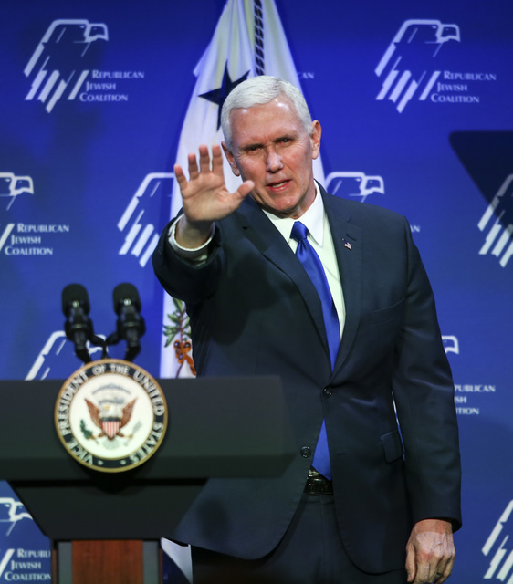 Vice President Mike Pence waves to the crowd after speaking before a dinner at the Republican Jewish Coalition's annual leadership meeting at the Venetian hotel-casino in Las Vegas on Friday, Feb. ...