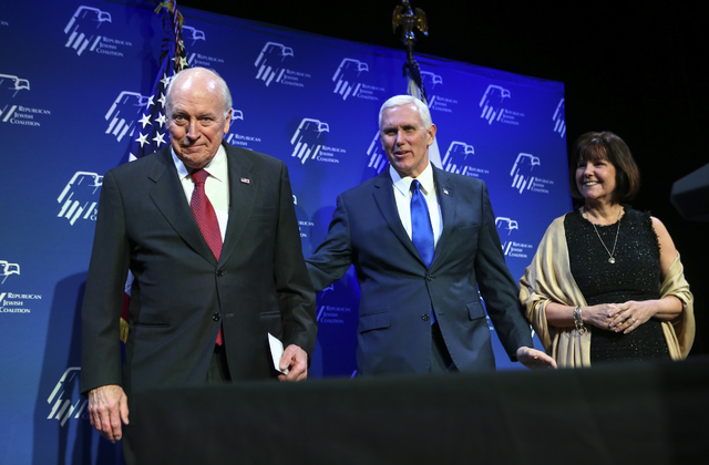 Former Vice President Dick Cheney, left, appears on stage with Vice President Mike Pence and his wife Karen before a dinner at the Republican Jewish Coalition's annual leadership meeting at the Ve ...