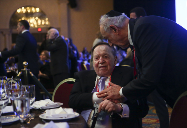 Las Vegas Sands Corp. Chairman and CEO Sheldon Adelson arrives for a dinner at the Republican Jewish Coalition's annual leadership meeting at the Venetian hotel-casino in Las Vegas on Friday, Feb. ...