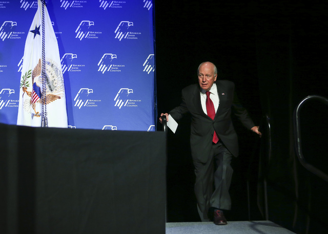 Former Vice President Dick Cheney walks on stage ahead of introducing Vice President Mike Pence before a dinner at the Republican Jewish Coalition's annual leadership meeting at the Venetian hotel ...