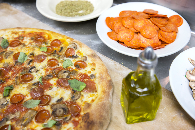 A freshly cooked Olde New York specialty pizza, made with thick slices of mozzarella, old school pepperoni, basil, mushrooms, Italian tomato sauce and pecorino romano cheese, on Thursday, Feb. 2,  ...