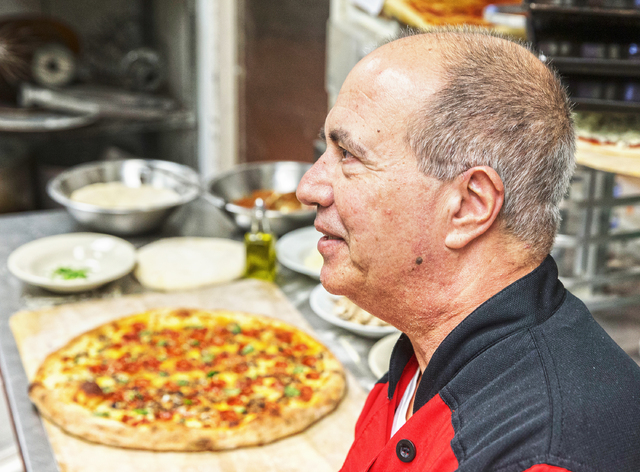 "Chef/co-owner John Arena in the kitchen of Metro Pizza on Thursday, Feb. 2, 2017, in Henderson. ""Pizza doesn't just have to be a vocation,"" said Arena. ""It can also be a ..."