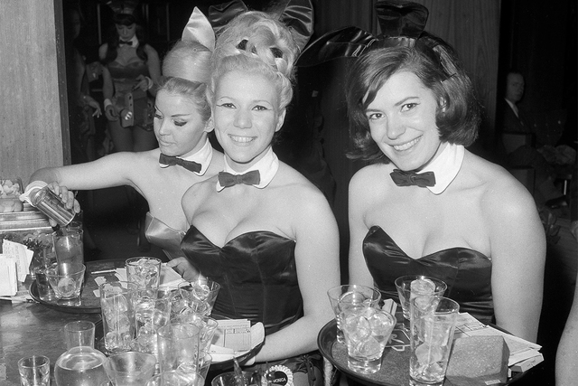 Playboy Bunnies Elka Hellmann, left, Monica Schaller and Sabrina Scharf serve drinks at New York's Playboy Club, Jan. 15, 1963. The tightly corseted Playboy Bunnies will soon be back in business i ...