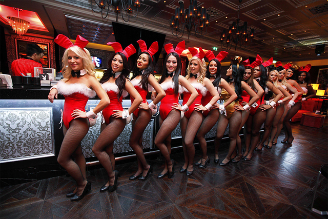 Waitresses pose inside the Playboy Club at the Sands Casino in Macau, Dec. 18, 2010. The club closed in 2013. (Kin Cheung/AP)