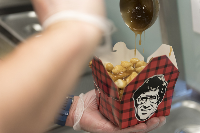 Robert Buckel, co-owner of Smoke's Poutinerie at Pawn Plaza, prepares traditional poutine at his restaurant in Las Vegas Friday, July 8, 2016. (Jason Ogulnik/Las Vegas Review-Journal)