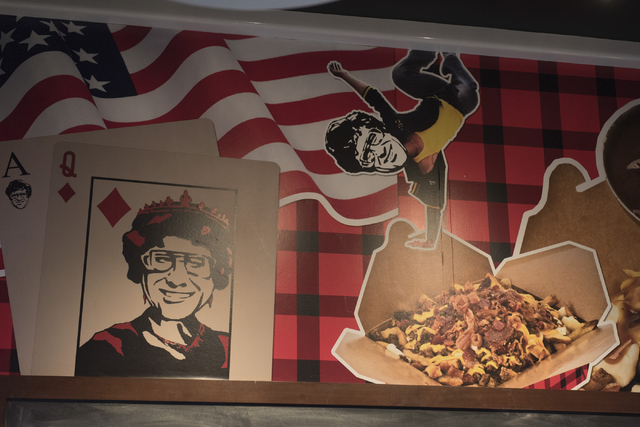 The wallpaper inside Smoke's Poutinerie at Pawn Plaza in Las Vegas is seen Friday, July 8, 2016. (Jason Ogulnik/Las Vegas Review-Journal)