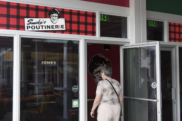 A customer enters Smoke's Poutinerie at Pawn Plaza in Las Vegas Friday, July 8, 2016. (Jason Ogulnik/Las Vegas Review-Journal)