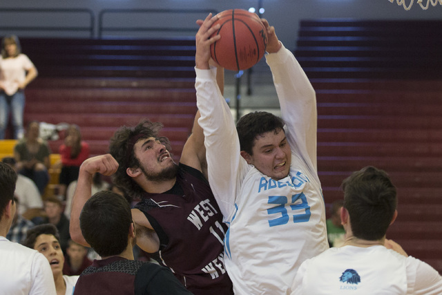 Adelson senior Brandon Pappas gets West Wendover's rebound during the 2A boys state semifinal game at Del Sol High School on Friday, Feb. 24, 2017, in Las Vegas.  (Bridget Bennett/Las Vegas Review ...
