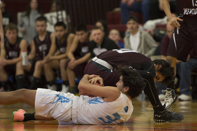 West Wendover junior Saul Palacios, right, looses possession of the ball to Adelson senior Jacob Elharrar during the 2A boys state semifinal game at Del Sol High School on Friday, Feb. 24, 2017, i ...