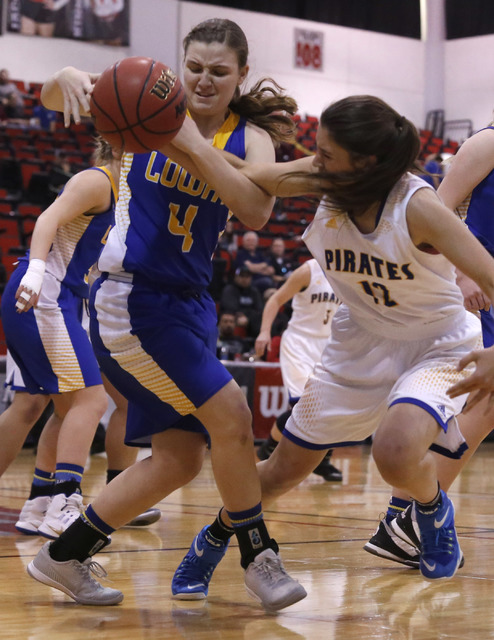 Lowry's Broklyn Backus (12) and Moapa Valley's Madison Bush (12) struggle for a loose ball during the first half of a Class 3A girls state semifinal game at the Cox Pavillion Center on Friday, Feb ...