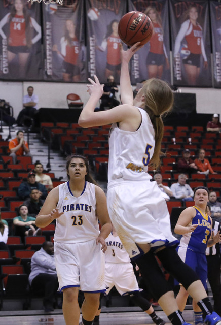 Moapa Valley's Kinlee Marshall (5) shoots during the first half of a Class 3A girls state semifinal game at the Cox Pavillion Center on Friday, Feb. 24, 2017, in Las Vegas. (Christian K. Lee/Las V ...