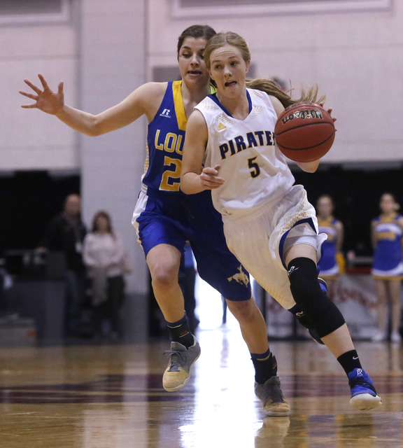 Moapa Valley's Kinlee Marshall (5) drives the ball pass a Lowry play during the first half of a Class 3A girls state semifinal game at the Cox Pavillion Center on Friday, Feb. 24, 2017, in Las Veg ...