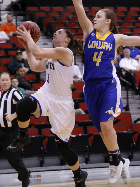 Moapa Valley's Lainey Cornwall (3) shoots on Lowry's Sydney Connors (4) during the first half of a Class 3A girls state semifinal game at the Cox Pavillion Center on Friday, Feb. 24, 2017, in Las  ...