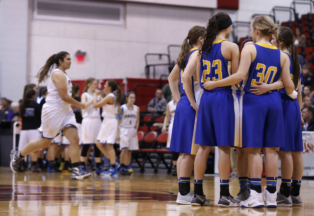 Lowry players huddle during introductions before the first half of a Class 3A girls state semifinal game at the Cox Pavillion Center on Friday, Feb. 24, 2017, in Las Vegas. (Christian K. Lee/Las V ...