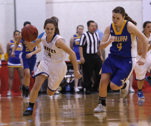 Moapa Valley's Matilda Thompson (4) dribbles pass Lowry's Sydney Connors (4) during the first half of a Class 3A girls state semifinal game at the Cox Pavillion Center on Friday, Feb. 24, 2017, in ...