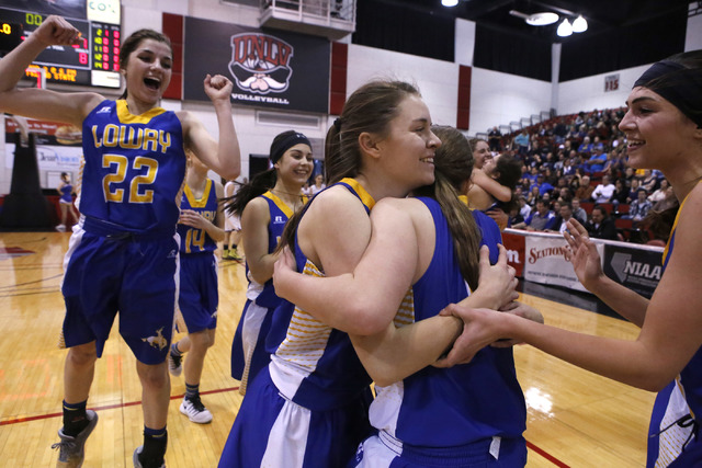 Lowry players celebrate after winning a Class 3A girls state semifinal game against Moapa Valley at the Cox Pavillion Center on Friday, Feb. 24, 2017, in Las Vegas. (Christian K. Lee/Las Vegas Rev ...