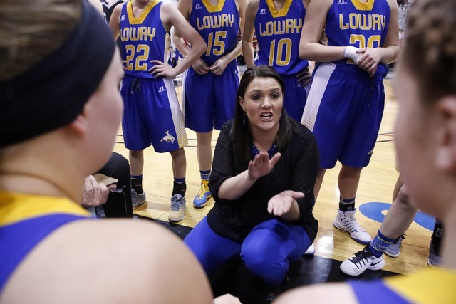 Lowry's head coach Chelsea Cabatbat speaks to the players during the second half of Class 3A girls state semifinal game at the Cox Pavillion Center on Friday, Feb. 24, 2017, in Las Vegas. (Christi ...