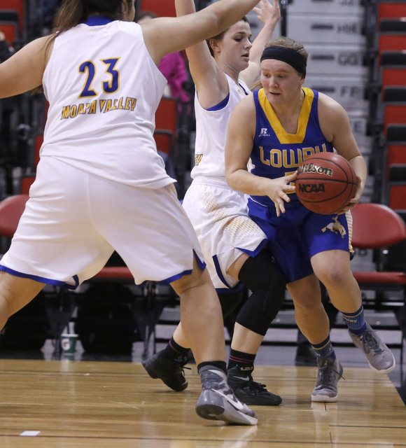 Lowry's Tiana Herrera (5) drives the ball pass Moapa Valley's Kaila Enosa (23) during the second half of Class 3A girls state semifinal game at the Cox Pavillion Center on Friday, Feb. 24, 2017, i ...