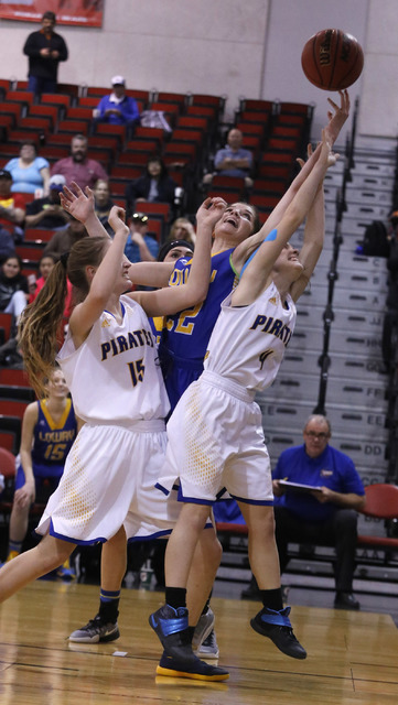 Lowry's Broklyn Waller (22), Moapa Valley's Shelbi Walker (15) and Moapa Valley's Matilda Thompson (4) jumps after a loose ball during the second half of a Class 3A girls state semifinal game at t ...