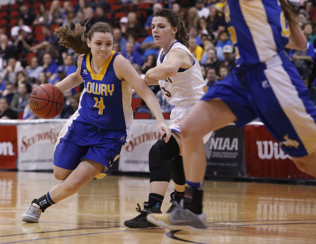 Lowry's Sydney Connors (4) drives towards the hoop during the second half of a Class 3A girls state semifinal game at the Cox Pavillion Center on Friday, Feb. 24, 2017, in Las Vegas. (Christian K. ...