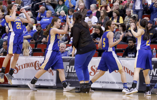 Lowry players slap their coach hand at a timeout during the second half of a Class 3A girls state semifinal game at the Cox Pavillion Center on Friday, Feb. 24, 2017, in Las Vegas. (Christian K. L ...