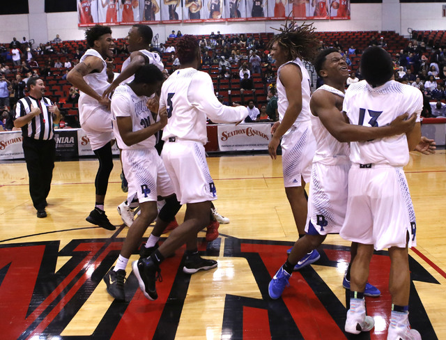 Desert Pine's players react after winning a Class 3A boys state final championship game at the Cox Pavillion on Saturday, Feb. 25, 2017, in Las Vegas. Desert Pine won 69-46. (Christian K. Lee/Las  ...