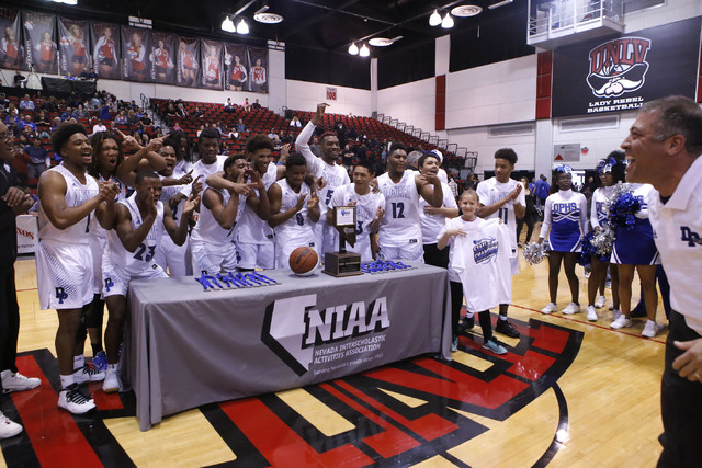 Desert Pines players react after winning a Class 3A boys state final championship game at the Cox Pavillion on Saturday, Feb. 25, 2017, in Las Vegas. Desert Pine won 69-46. (Christian K. Lee/Las V ...