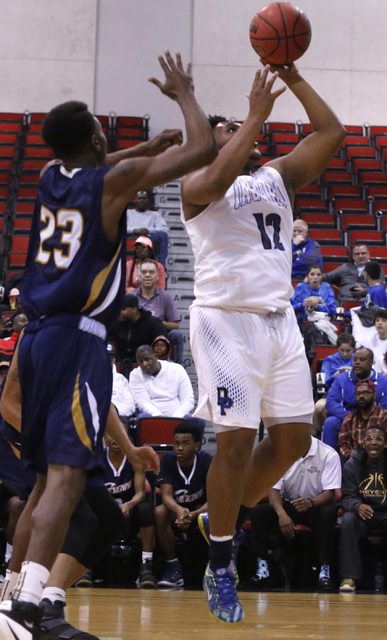 "Cheyenne""s Jaiden Martin (12) over Desert Pine's Donovan Word (23) during the first half of a Class 3A boys state final championship game at the Cox Pavillion on Saturday, Feb. 25, 2017,  ..."