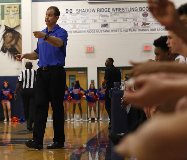 Bishop Gorman's head coach Grant Rice reacts during the second half of a Class 4A Sunset Region championship boys basketball game on Saturday, Feb. 18, 2017, in North Las Vegas. Bishop Gorman won  ...