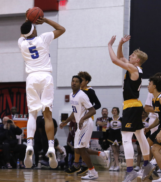 Bishop Gorman's Chuck O'Bannon (5) shoots over Clark's Trey Woodbury (22) during the first half of a Class 4A boys state final game at the Cox Pavillion on Friday, Feb. 24, 2017, in Las Vegas. (Ch ...