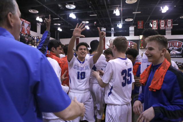Bishop Gorman's players react after winning a Class 4A boys state final championship game at the Cox Pavillion on Friday, Feb. 24, 2017, in Las Vegas. (Christian K. Lee/Las Vegas Review-Journal) @ ...