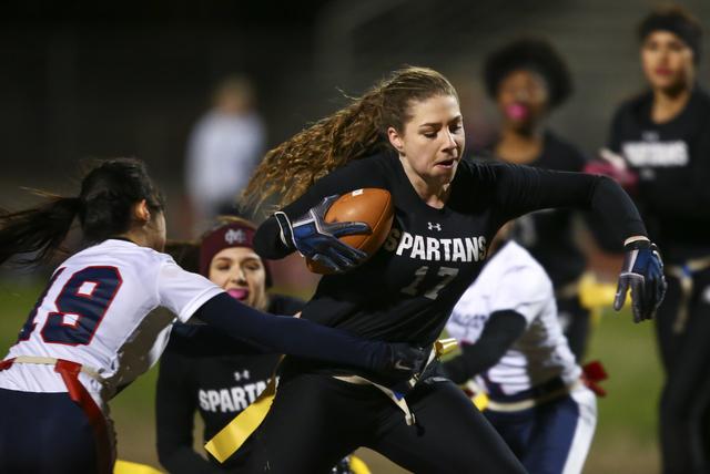 Cimarron-Memorial's Alyssa Karpinski (17) evades Coronado's Sofia Herrera (19) during the Class 4A state championship flag football game at Cimarron-Memorial High School on Wednesday, Feb. 22, 201 ...