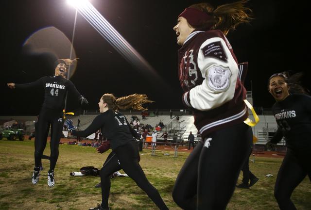 Cimarron-Memorial players, including Tiarra Del Rosario (44) and Alyssa Karpinski (17), celebrate after defeating Coronado 24-7 in the Class 4A state championship flag football game at Cimarron-Me ...
