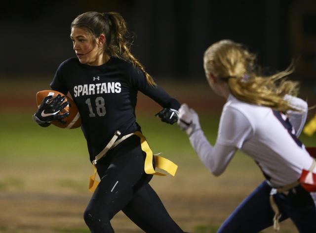 Cimarron-Memorial's Haylei Hughes (18) runs the ball against Coronado during the Class 4A state championship flag football game at Cimarron-Memorial High School on Wednesday, Feb. 22, 2017. Cimarr ...