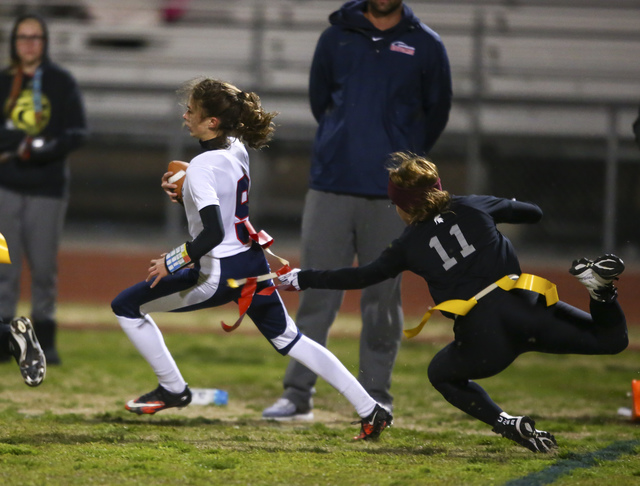 Coronado's Caitlin Shannon (9) is tagged out by Cimarron-Memorial's Maddison McCann during the Class 4A state championship flag football game at Cimarron-Memorial High School on Wednesday, Feb. 22 ...