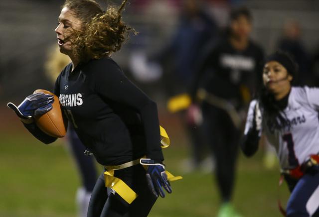 Cimarron-Memorial's Alyssa Karpinski (17) runs towards the end zone to score a touchdown against Coronado during the Class 4A state championship flag football game at Cimarron-Memorial High School ...
