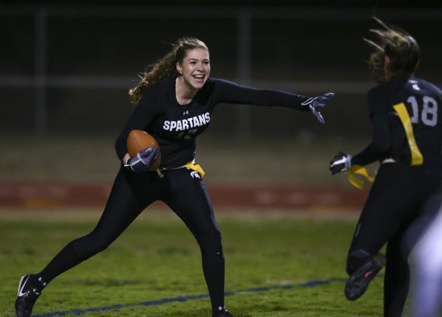 Cimarron-Memorial's Alyssa Karpinski (17) celebrates with Cimarron-Memorial's Haylei Hughes (18) after scoring a touchdown against Coronado during the Class 4A state championship flag football gam ...