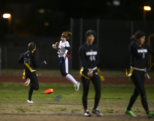 Coronado's Shawna Slater (3) celebrates after scoring a touchdown on an interception during the Class 4A state championship flag football game at Cimarron-Memorial High School on Wednesday, Feb. 2 ...