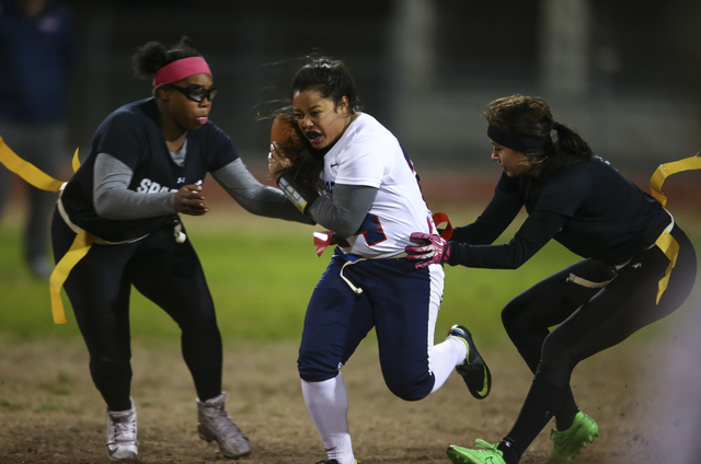 Coronado's Drew Stewart (24) is tagged out by Cimarron-Memorial's Dionna Whitley (9), left, and an unidentified player during the Class 4A state championship flag football game at Cimarron-Memoria ...