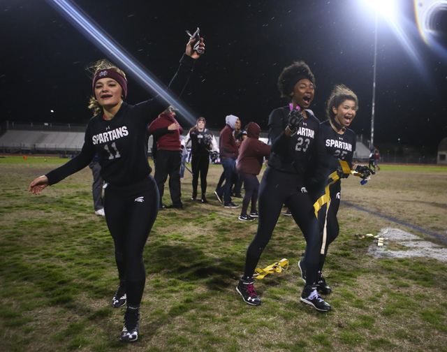 Cimarron-Memorial players celebrate after defeating Coronado 24-7 in the Class 4A state championship flag football game at Cimarron-Memorial High School on Wednesday, Feb. 22, 2017. (Chase Stevens ...