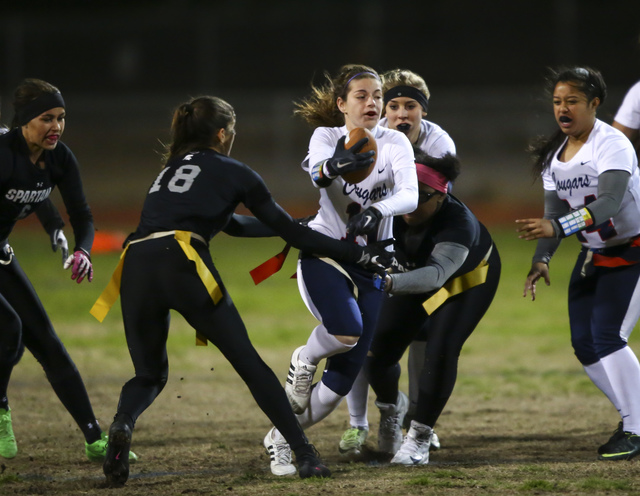 Coronado's Trinity Rhoades (11) is tagged out by Cimarron-Memorial's Haylei Hughes (18) and Dionna Whitley (9) during the Class 4A state championship flag football game at Cimarron-Memorial High S ...