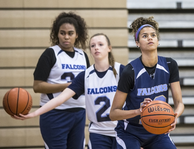 Foothill junior Rae Burrell, right, participates in shoot around at Mannion Middle School on Monday, Feb. 20, 2017, in Henderson. Burrell is poised to lead the Falcons into the Class 4A state girl ...