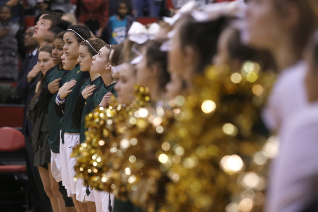Bishop Manogue players stand for the Star-Spangled Banner before the first half of a Class 4A girls state final game at the Cox Pavillion on Friday, Feb. 24, 2017, in Las Vegas. (Christian K. Lee/ ...